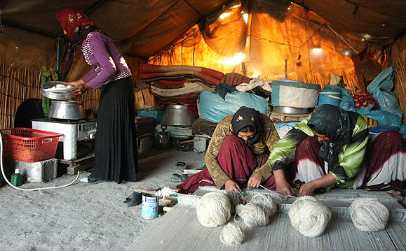 inside tents (cooking and waving carpet)